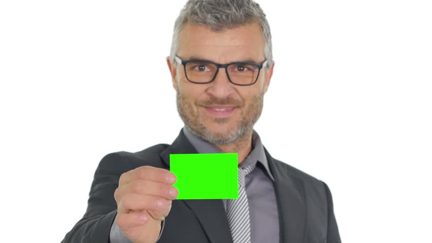 Business man giving a green business card to the camera happy mood pre keyed | Shutterstock HD Video #14252075