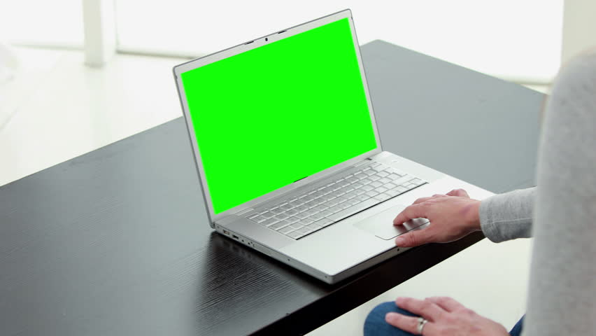 Over shoulder view of a couple using laptop at home