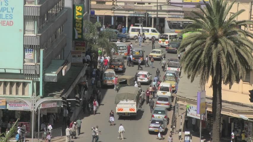 NAIROBI, KENYA - CIRCA 2009: Crowds and traffic on the streets circa 2009 in Nairobi, Kenya.  Kenyatta Avenue. - HD stock video clip