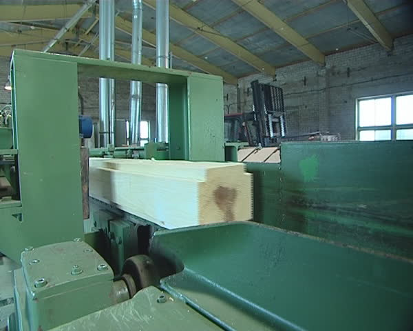 Wooden product made for construction industry from log. Wood processing in sawmill.  - SD stock video clip