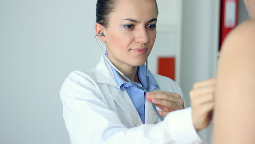 Female doctor examining patient with a stethoscope - HD stock footage clip