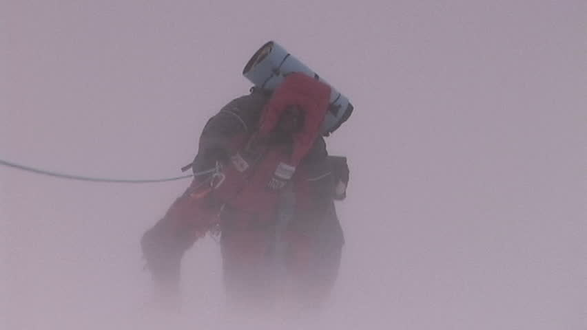 Climbers fight brutal storm on Mt. Everest - SD stock video clip