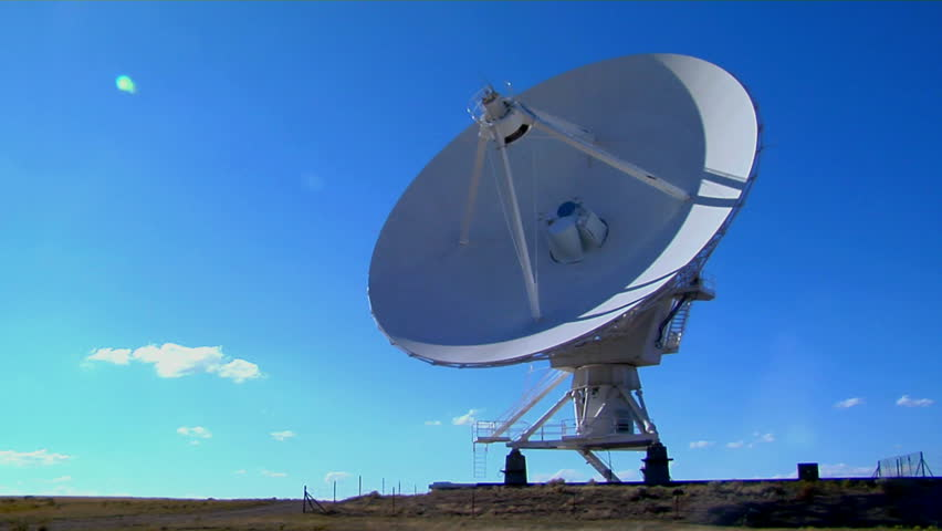 Time-lapse of a huge satellite dish moving - HD stock footage clip