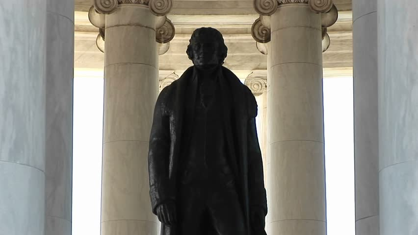 A statue of Thomas Jefferson is seen standing inside the Jefferson Memorial Building.