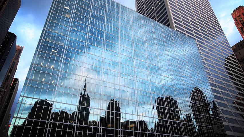 Office building reflects cloud time lapse
