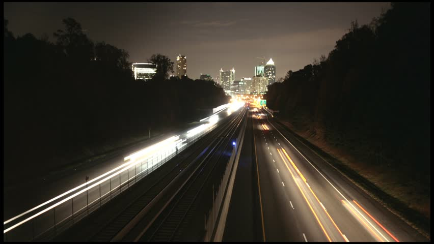 Timelapse of highway with City Skyline on the horizon at night SD - HD stock footage clip