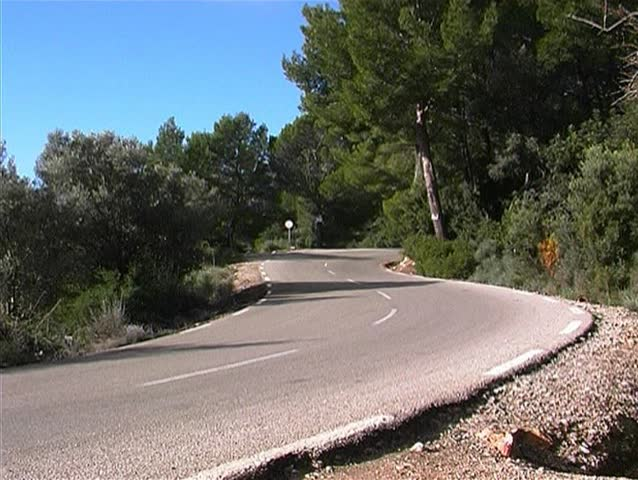 Coast road and passing blue car at the west coast of Majorca, Spain 9 - SD stock footage clip