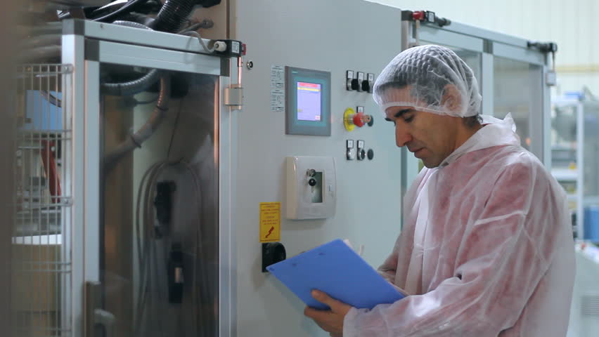 Worker controls the sugar packing machine - HD stock video clip