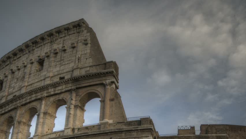 ROME, ITALY - OCTOBER 25 2011 (Timelapse): Timelapse of Colosseum at sunset at 25th of October 2011 in Rome, Italy - HD stock video clip