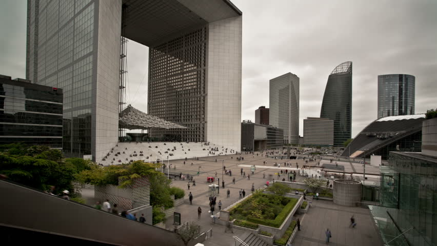 Timelapse  Business people in front of La Grand Arched in  La Defense district of Paris France