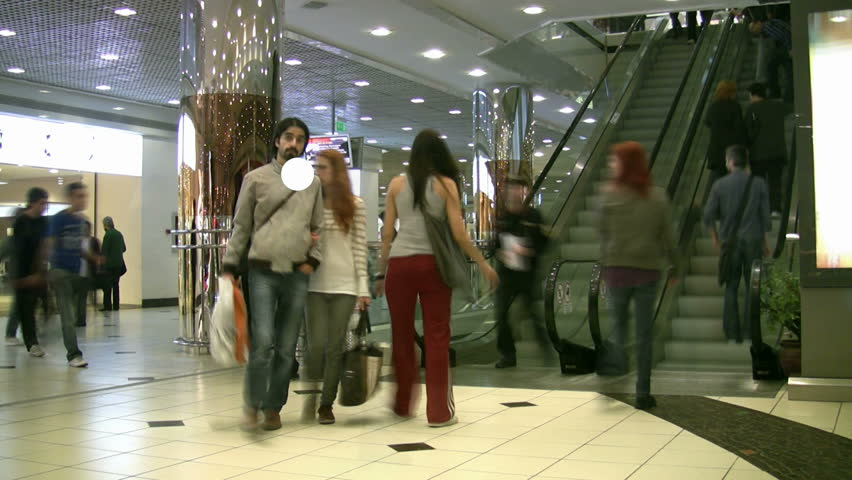 ISTANBUL - JULY 1: (Timelapse View) Consumers travel down escalator and shop in challenging economy at Istanbul Cevahir Shopping and Entertainment Centre, the largest shopping centre in Europe, July 1, 2011 in Istanbul, Turkey. - HD stock video clip