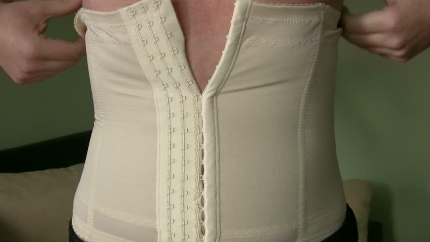 Women Applying corset - HD stock footage clip