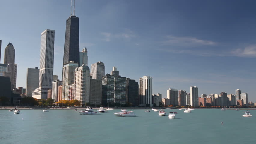 Scenic view of the Northern Chicago skyline from Navy Pier, with boats and Lake Michigan - HD stock footage clip