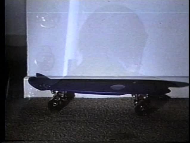 Close-up man slipping on skateboard