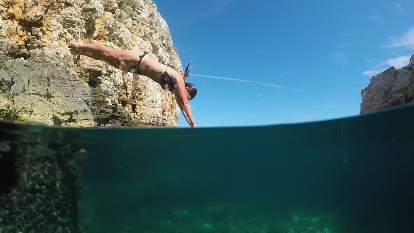 Diving into water from a cliff