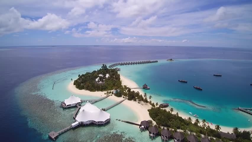 AERIAL: Luxurious Over-water Villas On Tropical Island ...