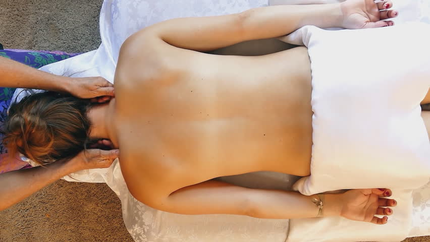 Professional female masseur making relaxing neck massage for a woman client in spa center | Shutterstock HD Video #18769679