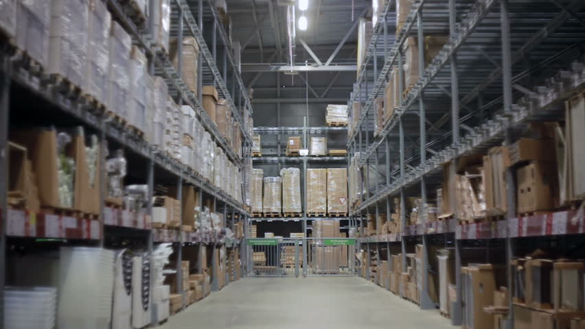 Camera moves between palettes with cardboard boxes and different materials in a storage warehouse | Shutterstock HD Video #18778301