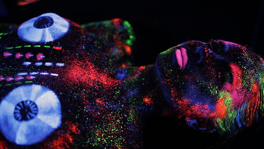 Hands DJ govern painted fluorescent powder on the body of a naked girl decks   Shutterstock HD Video #18820808