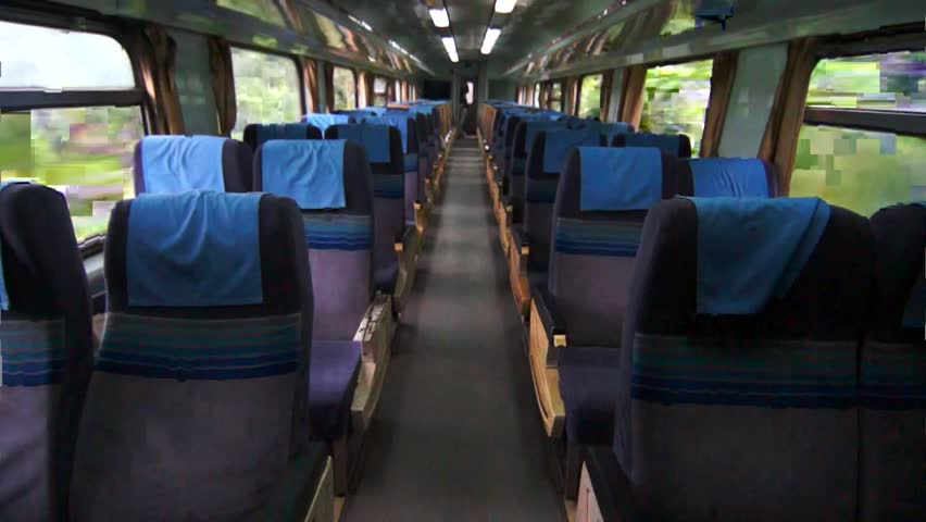 Interior of moving train with outside view from inside