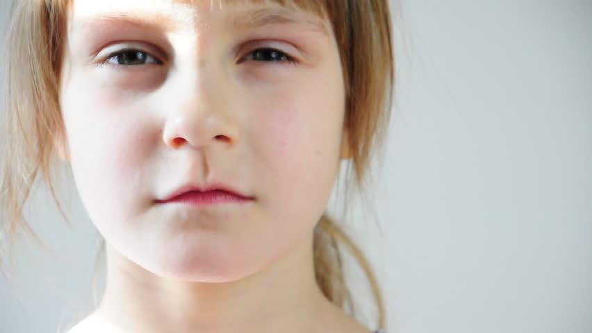 close-up portrait of a serious little girl  - HD stock video clip