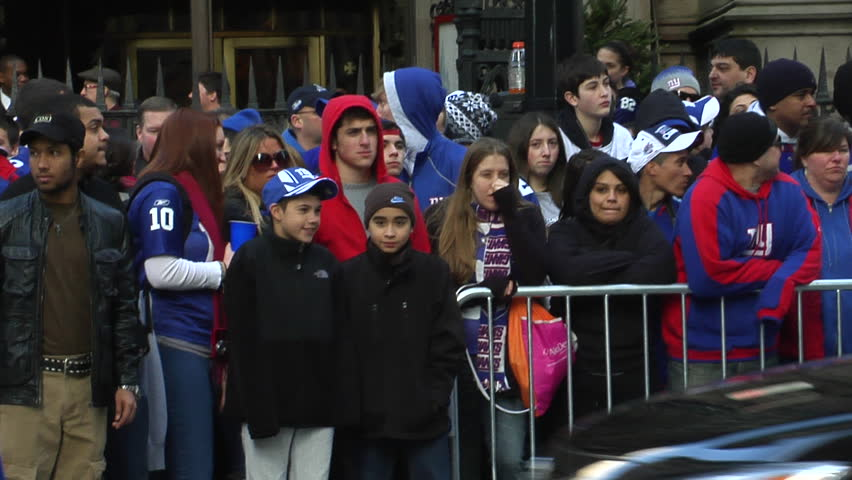 NEW YORK - FEBRUARY 7: Fans watch ticker-tape parade in honor of the Super Bowl Champions New York Giants on February 7, 2011 in New York.  - HD stock footage clip