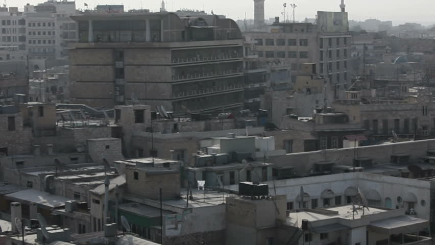 Aleppo panorama with Famous fortress and citadel in horizon, Syria. One of the oldest inhabited cities in the world. View to the north side wall. - HD stock footage clip
