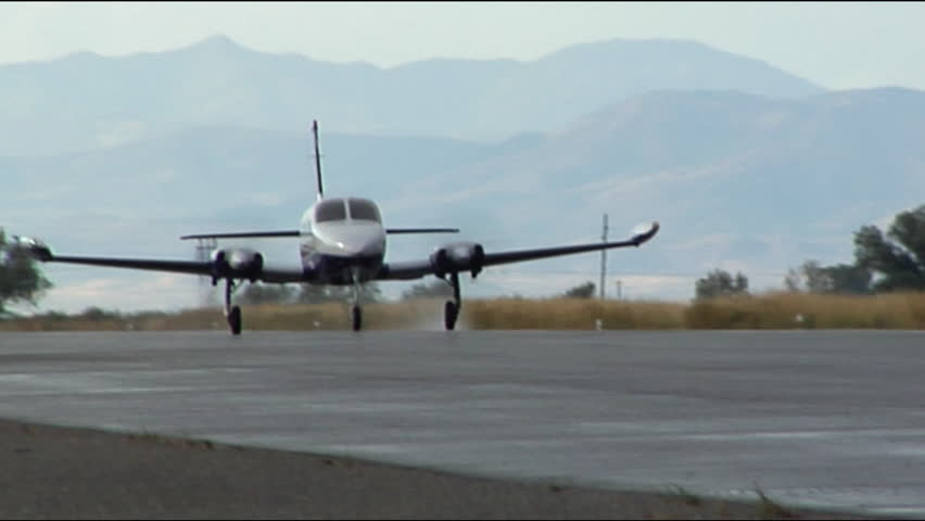 Twin Engine Plane Taking Off - HD stock video clip