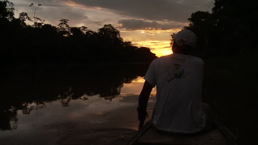 Paddling With Canoe On The Amazon River in front of the sunset, South America, Peru - HD stock footage clip