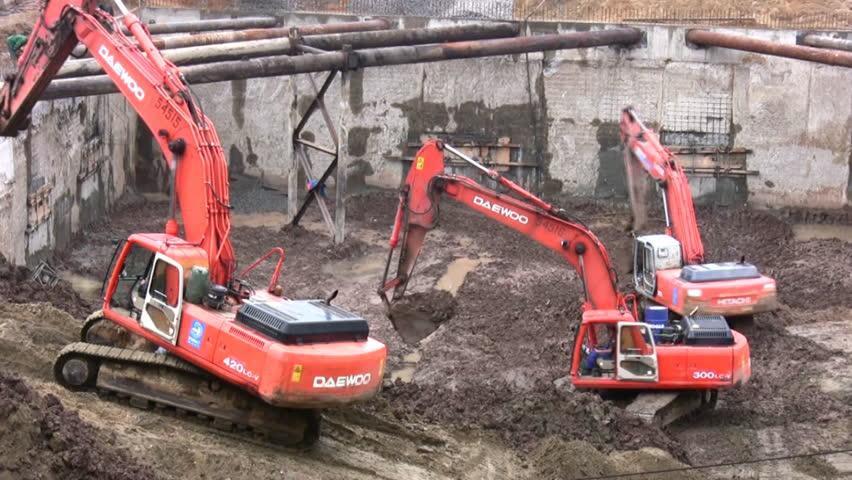 three excavators - HD stock footage clip