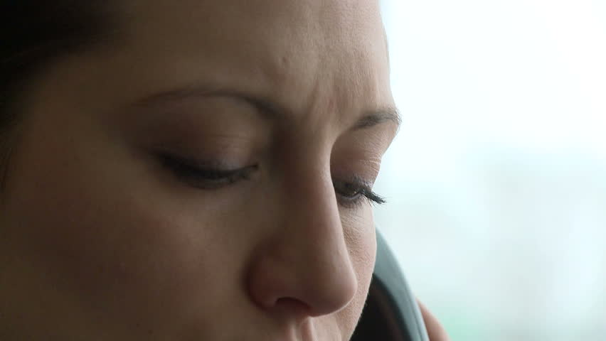 Female - Early 30's closeup of eyes during phone call - HD stock footage clip