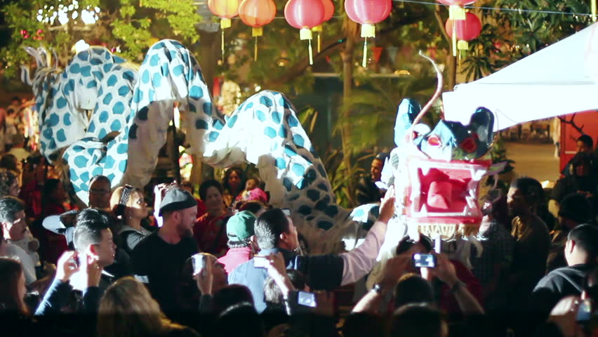 LOS ANGELES - MARCH 3: A Silver Dragon parades around the crowds at the Lantern Festival on March 3, 2012 in Los Angeles.  The festival is a popular annual family friendly event near Chinatown. - HD stock footage clip