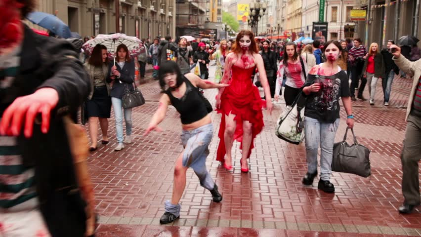 MOSCOW - MAY 14: Bloody zombies girls walk by street among people during Zombie Parade on May 13, 2011 in Moscow, Russia. - HD stock video clip