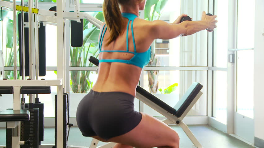 Woman working out doing squats - HD stock video clip