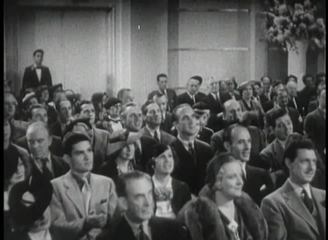 Wide shot of 1930s audience applauding - SD stock video clip