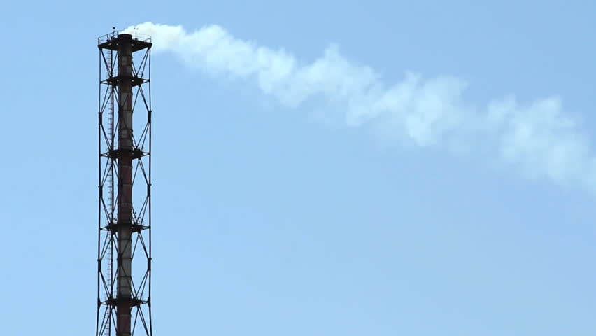 tube with smoke over blue sky - HD stock video clip
