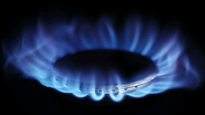 Natural gas inflammation in stove burner, close up view - HD stock footage clip
