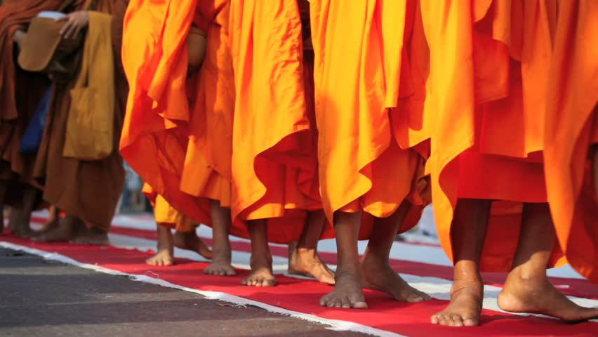 BANGKOK, MARCH 25, 2012: Monks are participating in a Mass Alms Giving of 12,600 monks in Central World for the Makha Bucha celebrations in Bangkok, Thailand - HD stock footage clip