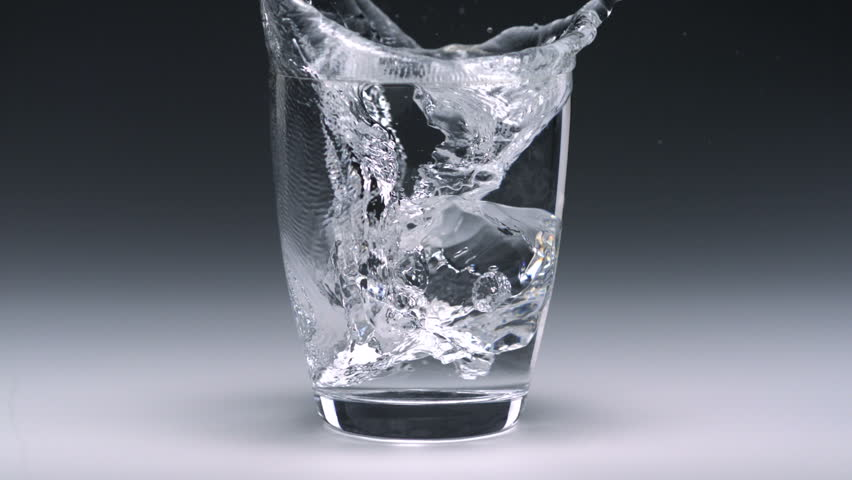 Super slo-mo ice cube falling into glass - HD stock video clip