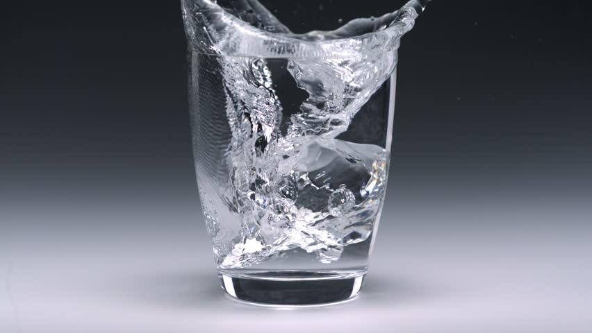 Super slo-mo ice cube falling into glass - HD stock video clip