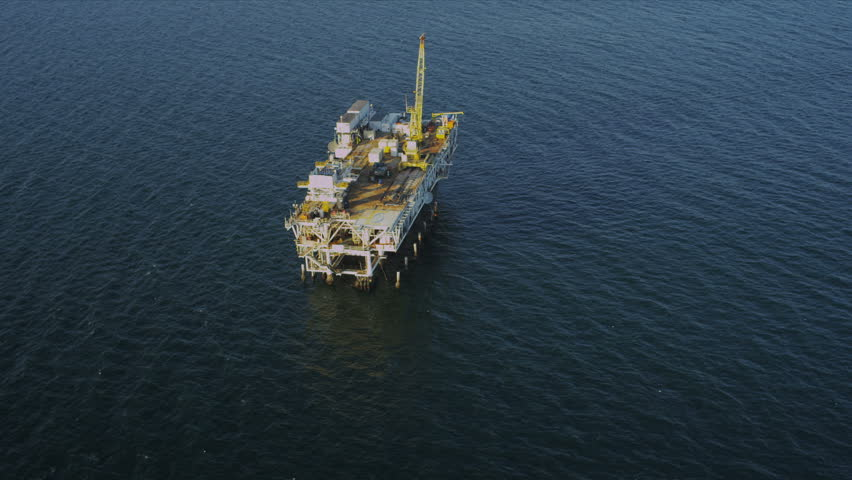 Aerial view of deep ocean offshore oil producing platform, USA - HD stock video clip