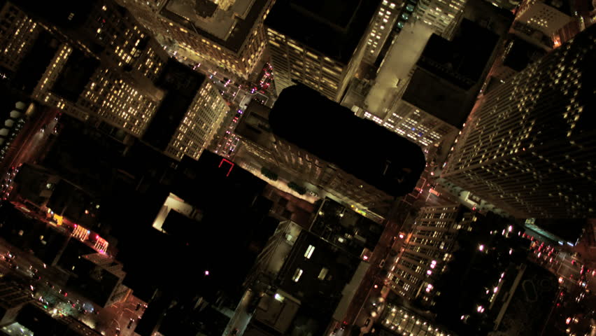 Aerial night vertical view of skyscrapers and streets in an urban illuminated Metropolis | Shutterstock HD Video #2128922