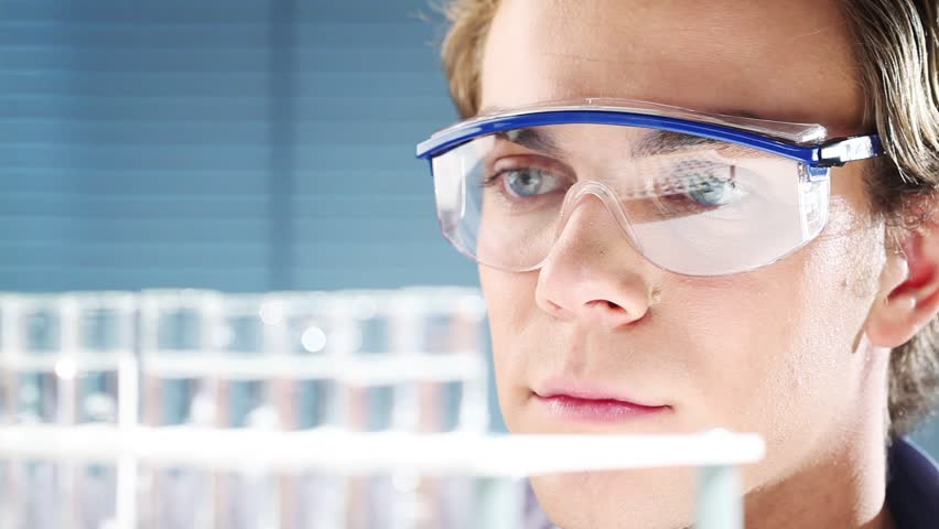 Young scientist in medical laboratory finding a cure for cancer - HD stock footage clip