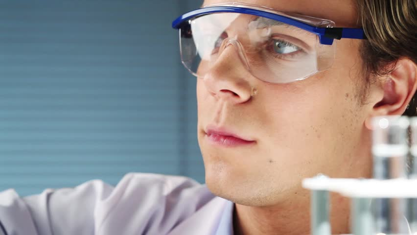 Young scientist in medical laboratory finding dna - HD stock footage clip