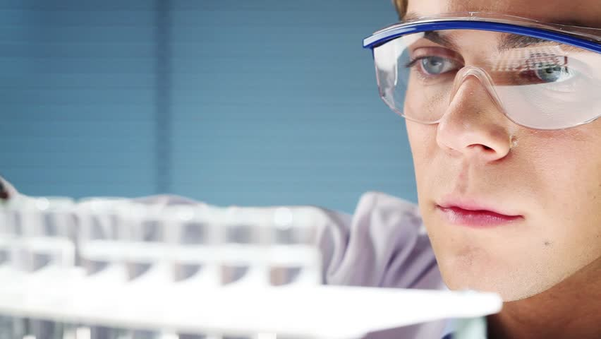 Young scientist in medical laboratory discovering new drugs - HD stock video clip