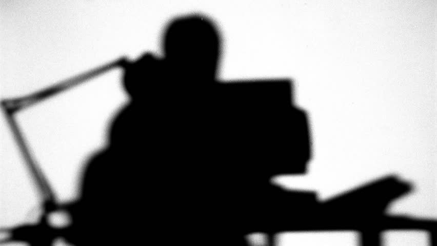 Silhouette of man working on computer - HD stock video clip