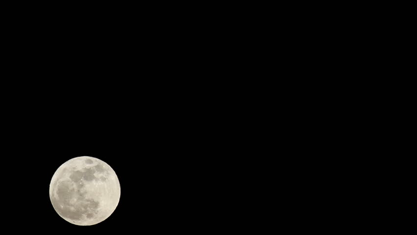 Full Supermoon passes fast time lapse across black night sky. Historic large moon in May 2012. Detail of landscape, craters and plains. Solar system closest body to earth. Fast time lapse.