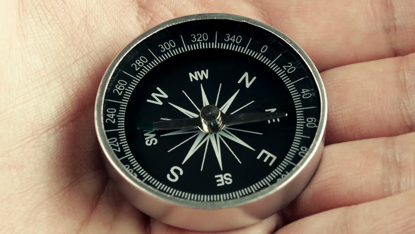 Compass Magnetic North Lost (HD). Compass specially rigged to show unstable north motion by using magnets. Could be used for the magnetic north flip theme or exploration without direction.