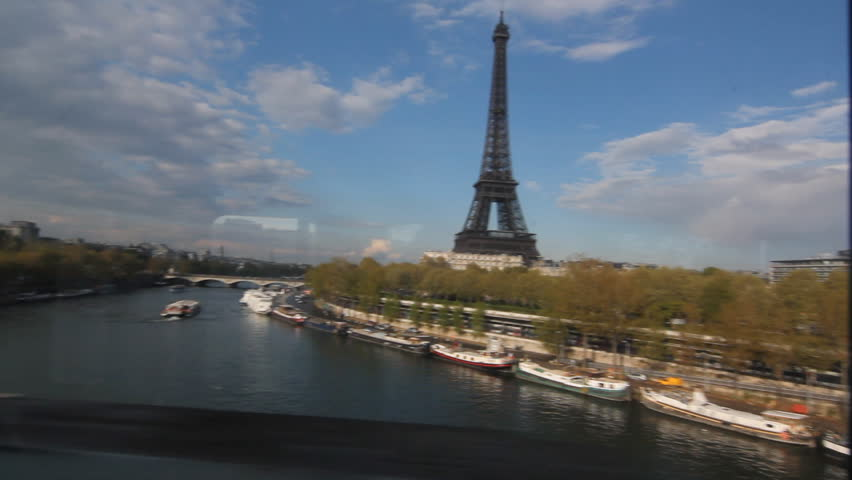 Eiffel Tower from Metro train. View of the Eiffel Tower and the Seine shot through the window of a metro train. Paris, France.