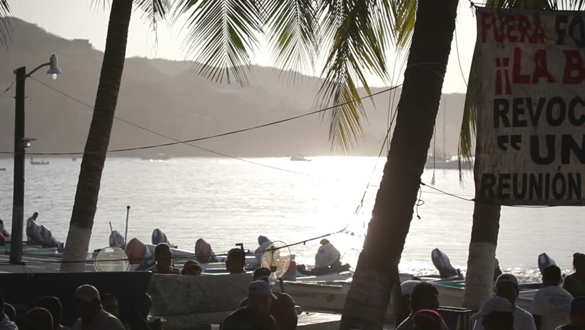 ZIHUATANEJO - JANUARY 19: Fishermen arrive back from the sea with their morning catch to sell at the market, JANUARY 19, 2012 in Zihuatanejo, Mexico  - HD stock video clip